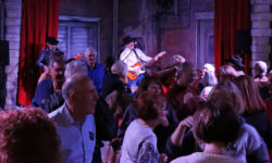 Tim Sullivan playing for a dancing crowd