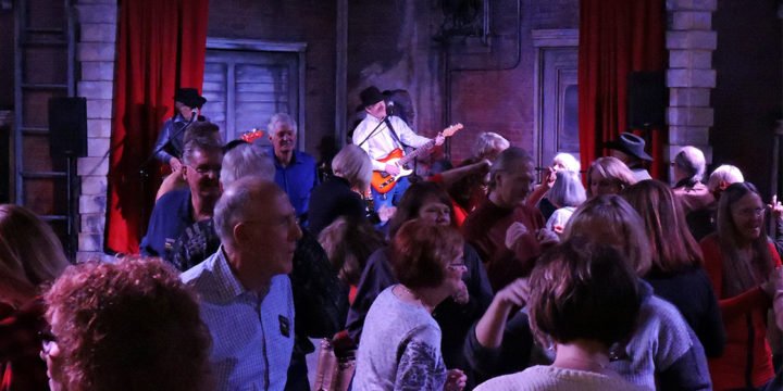 The Tim Sullivan band playing for a dancing crowd